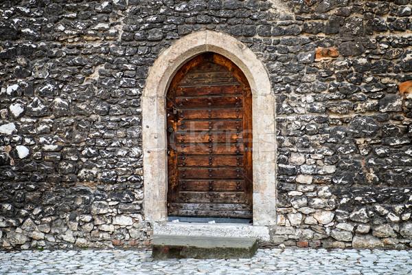 öreg fából készült ajtó kőfal ősi utca Stock fotó © vapi