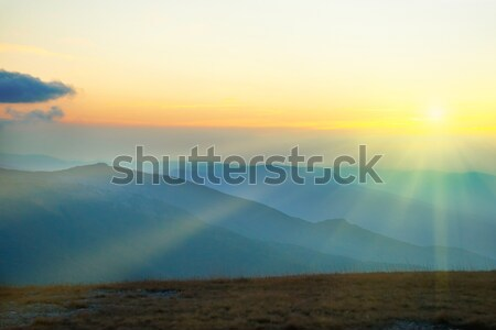 Stock photo: Beautiful sunset at the mountains