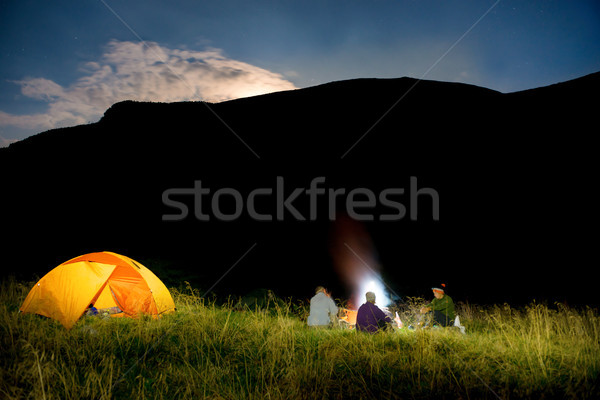 Stock photo: People near illuminated orange tent