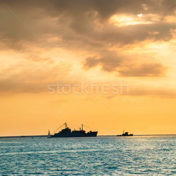 Sunset over blue sea with ship Stock photo © vapi