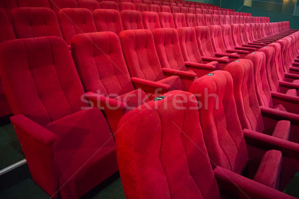 Aisle with rows of red seats Stock photo © vapi