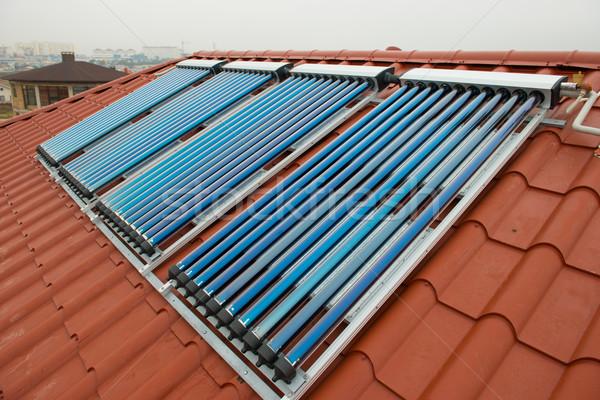 Vakuum solar Wasser Heizung rot Dach Stock foto © vapi