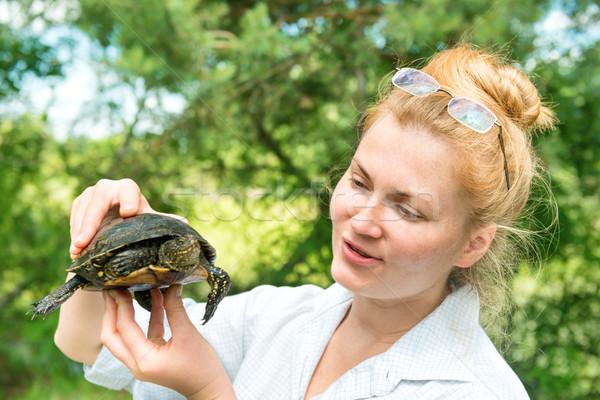 Pretty blond woman holding a turtle Stock photo © vapi