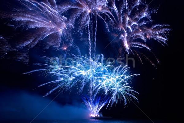 Colorido fogos de artifício preto céu água feliz Foto stock © vapi
