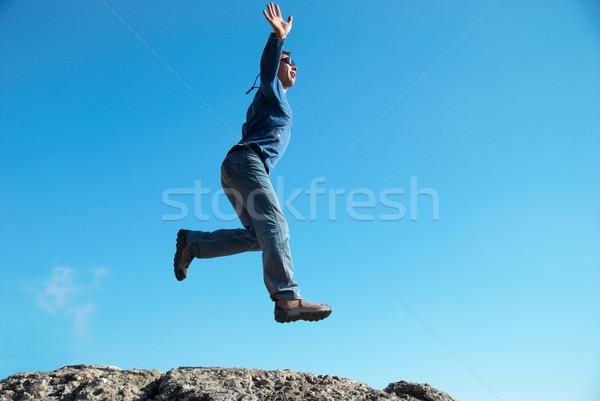 Stok fotoğraf: Adam · atlama · kayalar · manzara · mutlu · spor