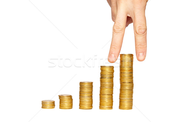 Successful hand on the top of gold coin's stack. Stock photo © vapi