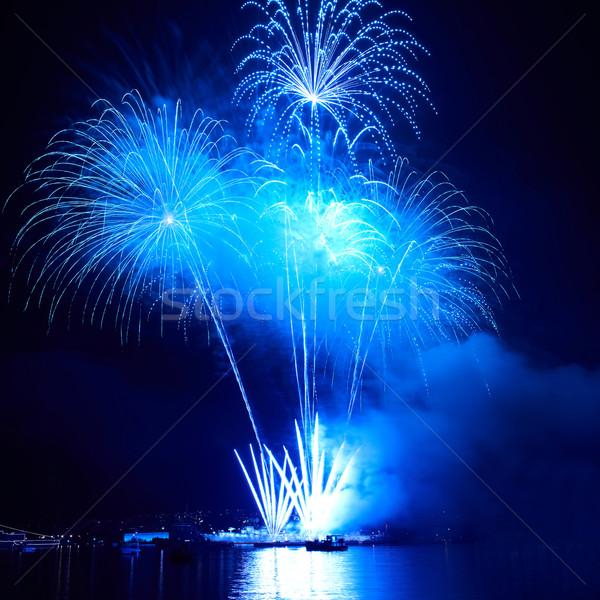Színes tűzijáték kék fekete égbolt boldog Stock fotó © vapi