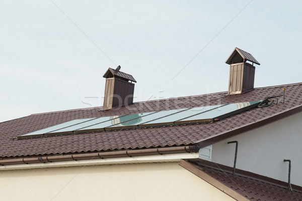 Stock photo: Solar panel (geliosystem) on the house roof.