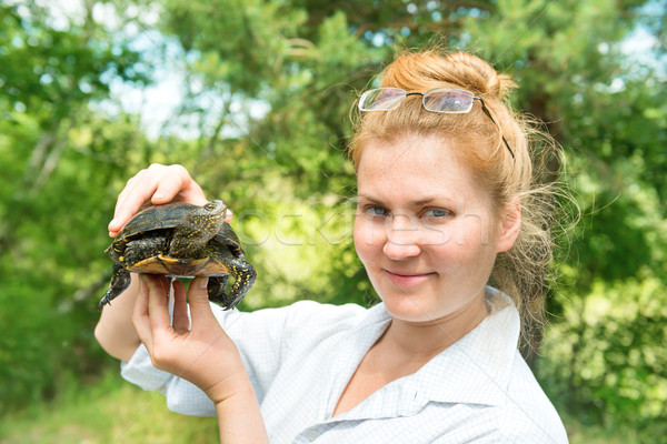 Pretty blond woman holding a turtle Stock photo © vapi