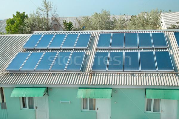 Zonnestelsel dak zonne water verwarming Rood Stockfoto © vapi