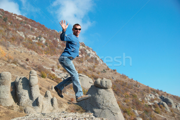 Man jumping on the rocks Stock photo © vapi