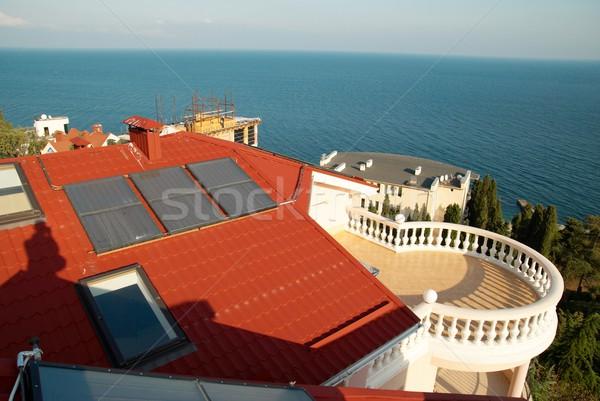 Alternatív energia naprendszer ház tető üzlet Stock fotó © vapi