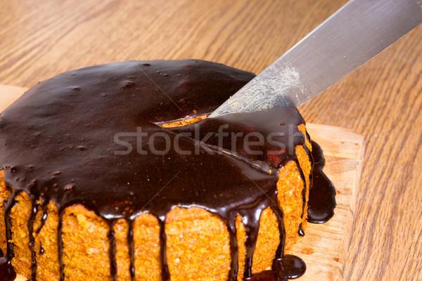 Sliced by knife chocolate birthday cake Stock photo © vapi