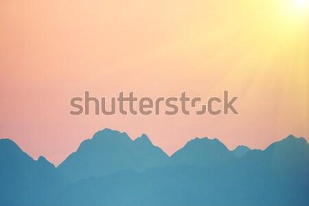 Sunset over mountains Stock photo © vapi