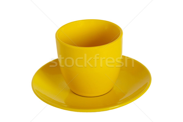 Stock photo: Yellow tea cup and saucer on white background.