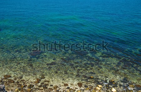 Stock photo: A coast with stones and blue ocean water.