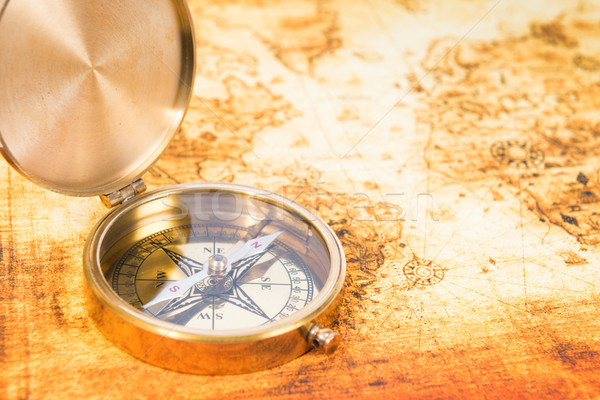 Old map with an ancient compass Stock photo © vapi