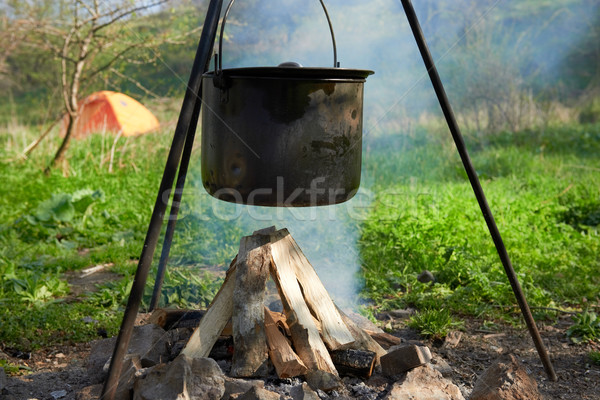 Stock photo: Pot boiling on the fire
