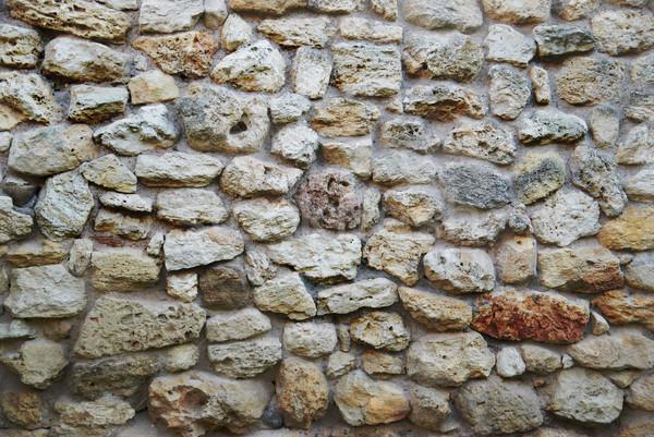Muro di pietra vecchio giallo antica mattoni texture Foto d'archivio © vapi