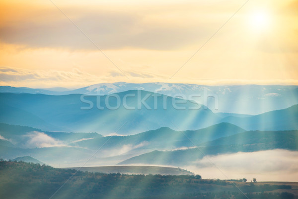 Blue mountains covered with mist  Stock photo © vapi