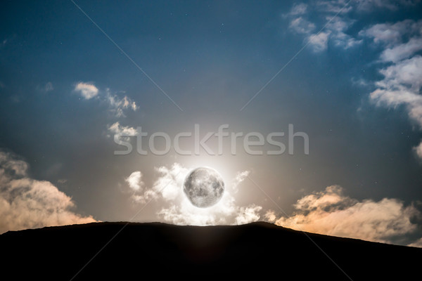 Luna piena sopra montagna buio blu cielo notturno Foto d'archivio © vapi
