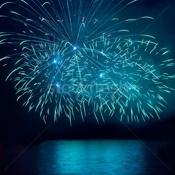 Kék tűzijáték fekete égbolt boldog fény Stock fotó © vapi