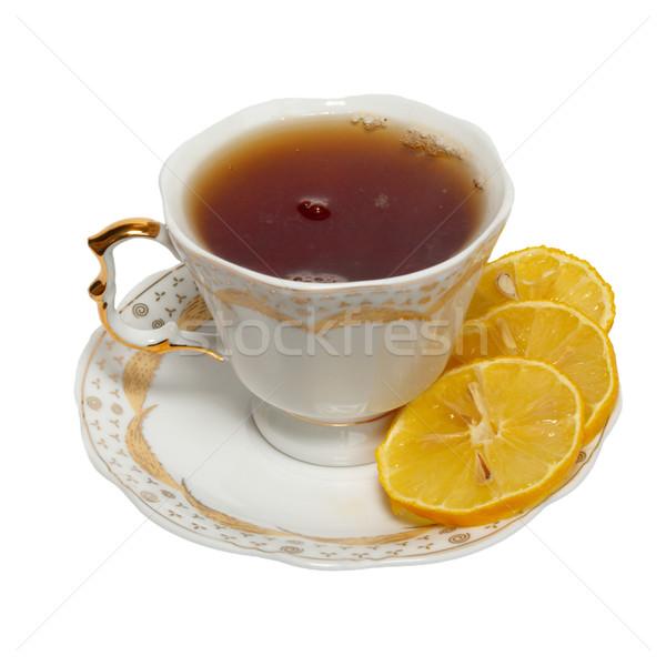 Teacup with tea and lemon isolated on white. Stock photo © vapi