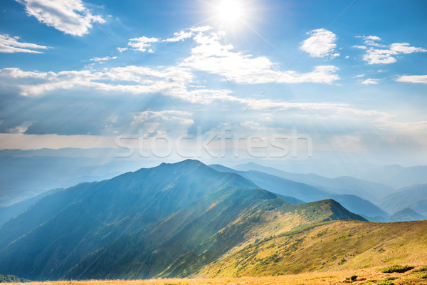 Paysage montagne gamme brillant soleil nuages Photo stock © vapi