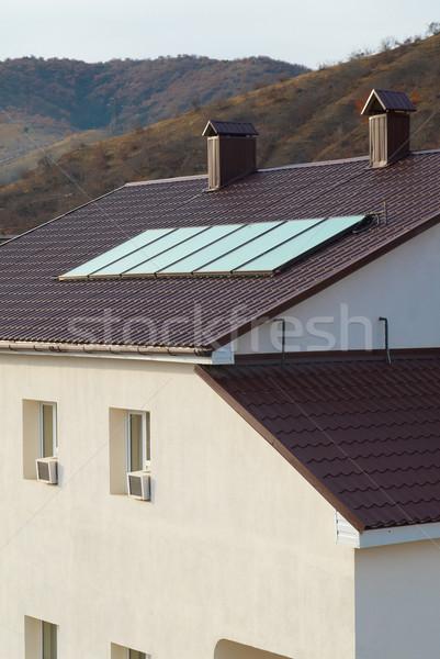 Zonnepaneel huis dak business technologie groene Stockfoto © vapi