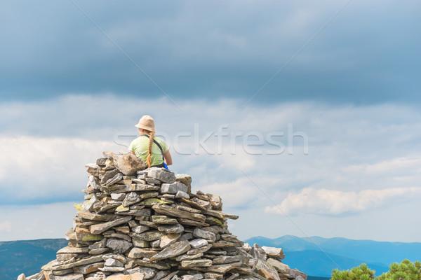 Fiatal nő ül felső hegy néz természet Stock fotó © vapi