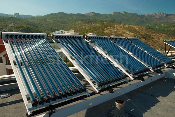 Vákuum nap víz fűtés ház tető Stock fotó © vapi