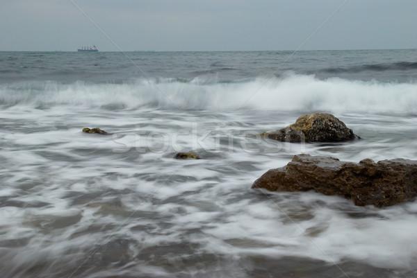 Coast with the vessel on the horizon. Stock photo © vapi