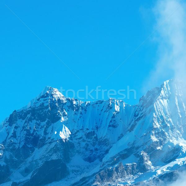 высокий гор покрытый снега Top облака Сток-фото © vapi