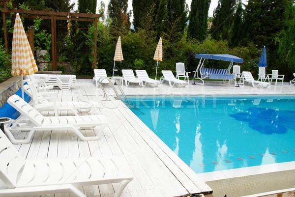 Swimming pool in the hotel Stock photo © vapi