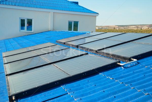 Foto stock: Solar · água · aquecimento · casa · telhado · céu