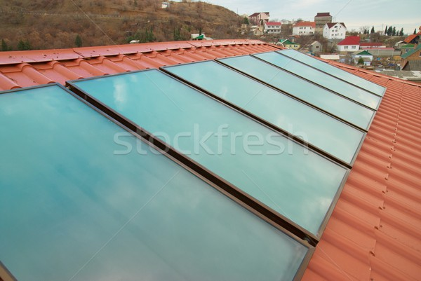 Solar panel (geliosystem) on the red roof. Stock photo © vapi