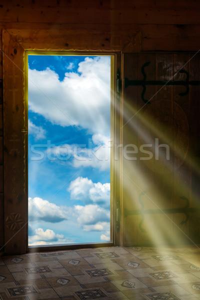 Sun light shining through door to new world Stock photo © vapi