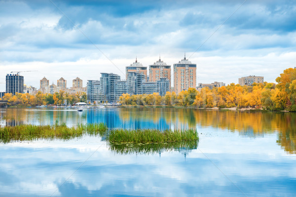 Lake with blue water and high buildings Stock photo © vapi