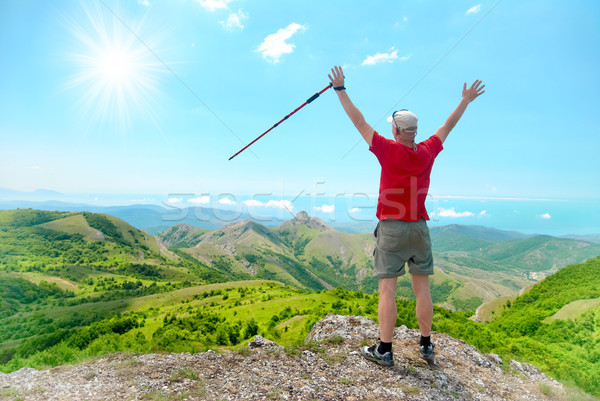 Young happy man with hiking stick Stock photo © vapi