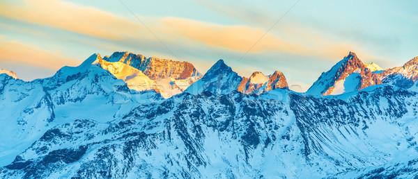 Hegyek hó naplemente panoráma tájkép égbolt Stock fotó © vapi