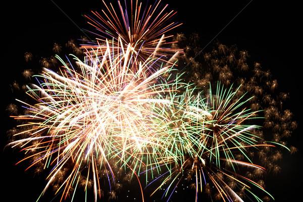 Stock fotó: ünnep · tűzijáték · éjszaka · fekete · égbolt · absztrakt