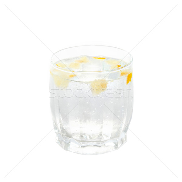 A cold water glass with lemon isolated on white. Stock photo © vapi