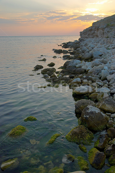 Stock photo: Sunset on the sea with the waves.