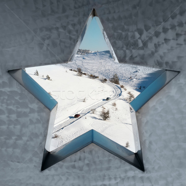 Stock photo: Snow-covered mountains through the star.