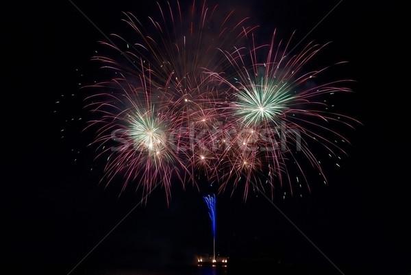 Színes tűzijáték fekete égbolt víz tűz Stock fotó © vapi