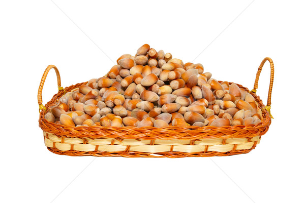 Heap of filberts in wicker basket isolated on white. Stock photo © vapi