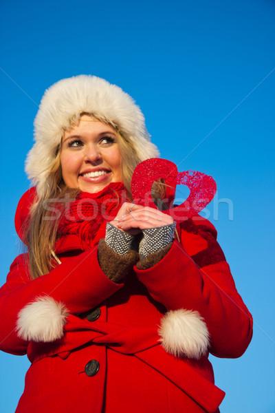 Kadın kırmızı kat kalp şekli genç Stok fotoğraf © varlyte