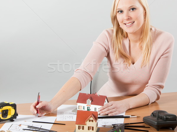 Stock photo: woman architect at her work table