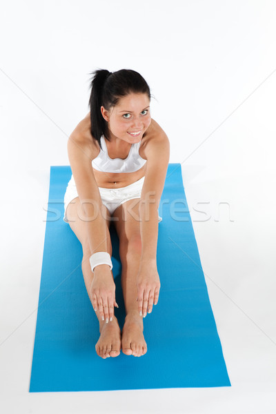 Stok fotoğraf: Kadın · yoga · egzersiz · genç · kadın · mavi · halı