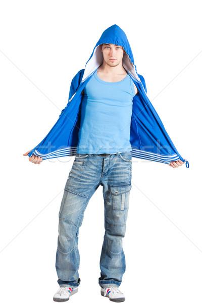 Yakışıklı genç gündelik mavi yalıtılmış Stok fotoğraf © varlyte